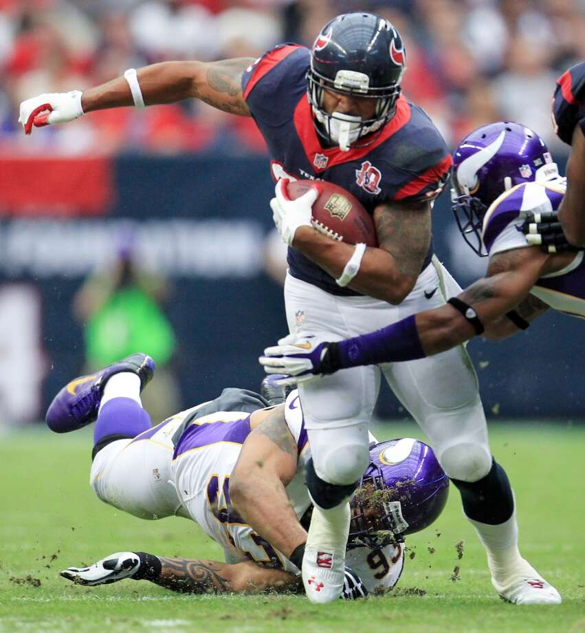Texans running back Arian Foster (23) gets past Vikings defensive tackle Kevin Williams (93) during the first quarter. (Karen Warren / Houston Chronicle)