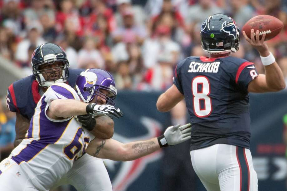 Texans quarterback Matt Schaub (8) gets off a pass as tackle Duane Brown (76) blocks Vikings defensive end Jared Allen (69) during the first quarter. (Smiley N. Pool / Houston Chronicle)