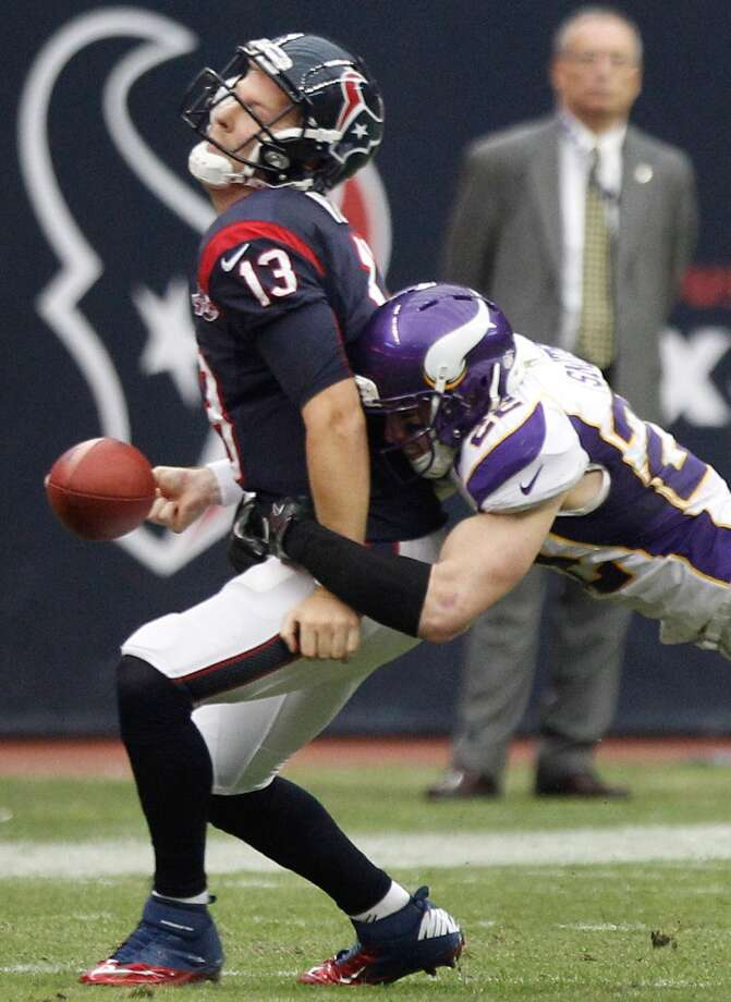 Texans quarterback T.J. Yates (13) fumbles as he is hit by Vikings free safety Harrison Smith (22) during the fourth quarter. (Brett Coomer / Houston Chronicle)