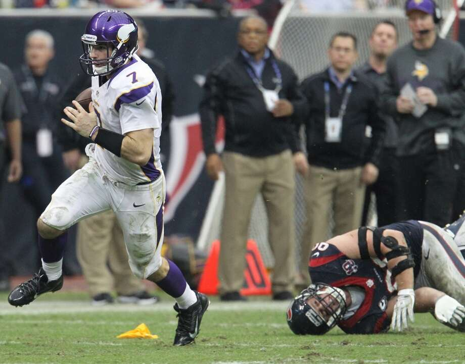 Vikings quarterback Christian Ponder (7) evades the tackle of Texans defensive end J.J. Watt (99) during the fourth quarter. (Karen Warren / Houston Chronicle)