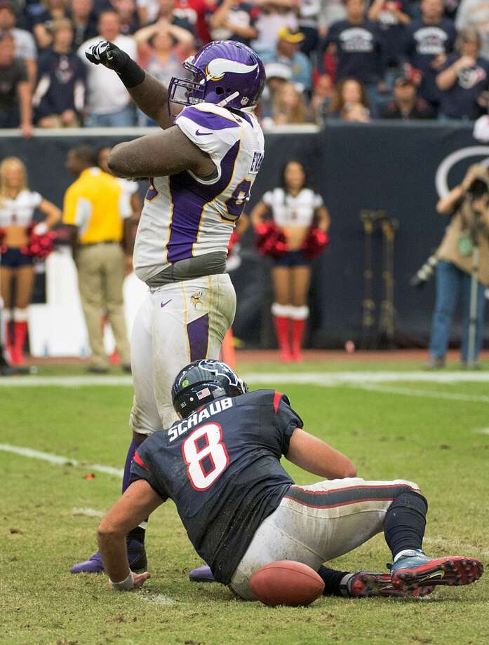 Vikings defensive tackle Fred Evans (90) celebrates after sacking Texans quarterback Matt Schaub (8) for a 14-yard loss. (Smiley N. Pool / Houston Chronicle)