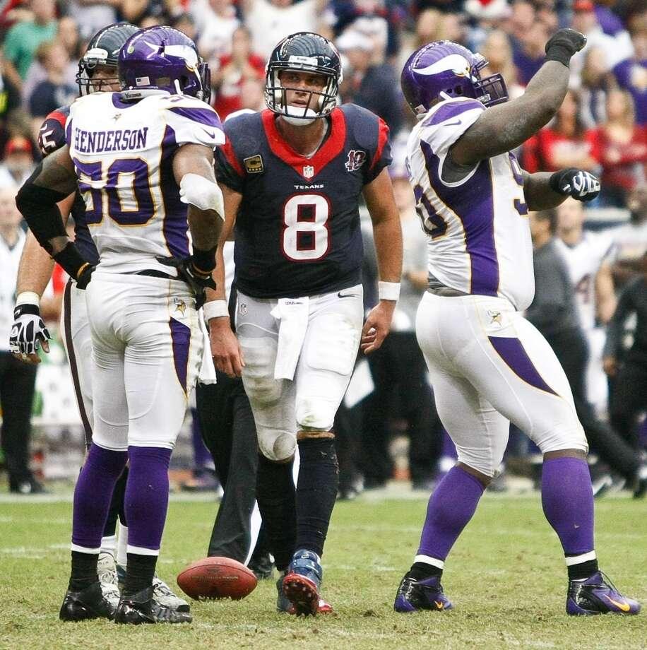 Vikings defensive tackle Fred Evans (90)  dances after sacking Texans quarterback Matt Schaub (8) during the fourth quarter. (Nick de la Torre / Houston Chronicle)
