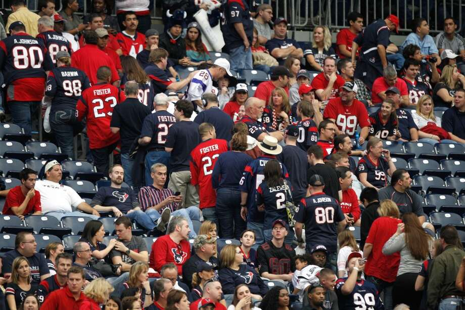 Texans fans leave the stadium during the fourth quarter against the Minnesota Vikings. (Brett Coomer / Houston Chronicle)