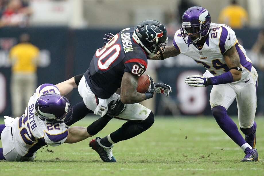 Texans wide receiver Andre Johnson (80) is brought down by Vikings free safety Harrison Smith (22) and cornerback A.J. Jefferson (24) during the third quarter. (Karen Warren / Houston Chronicle)