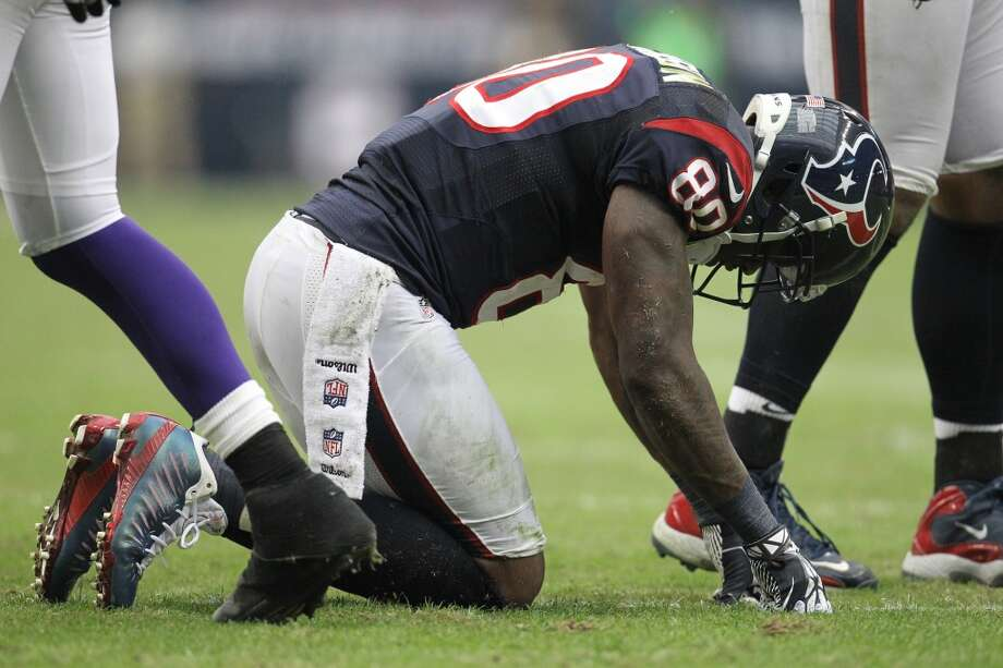 Texans wide receiver Andre Johnson gets up slowly after a play during the third quarter. (Karen Warren / Houston Chronicle)
