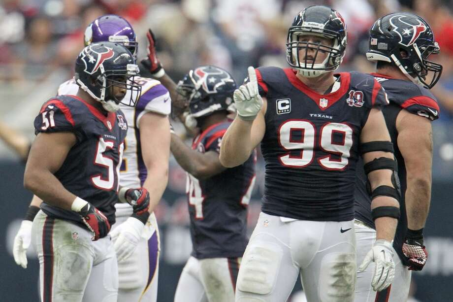 Texans defensive end J.J. Watt (99) gives his finger wag during the third quarter. (Karen Warren / Houston Chronicle)