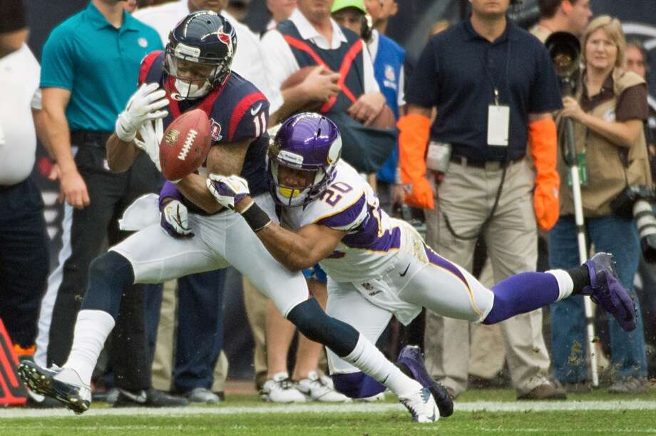 Vikings cornerback Chris Cook (20) breaks up a pass intended for Texans wide receiver DeVier Posey (11) during the first quarter. (Smiley N. Pool / Houston Chronicle)