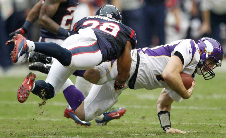 Vikings quarterback Christian Ponder (7) is brought down by Texans free safety Danieal Manning (38) during the second quarter. (Brett Coomer / Houston Chronicle)