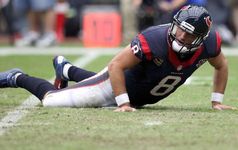 Texans quarterback Matt Schaub gets up slowly after a hit during the first quarter. (Nick de la Torre / Houston Chronicle)