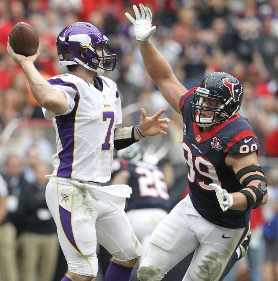 Texans defensive end J.J. Watt (99) applies pressure to Vikings quarterback Christian Ponder (7) during the first quarter. (Karen Warren / Houston Chronicle)