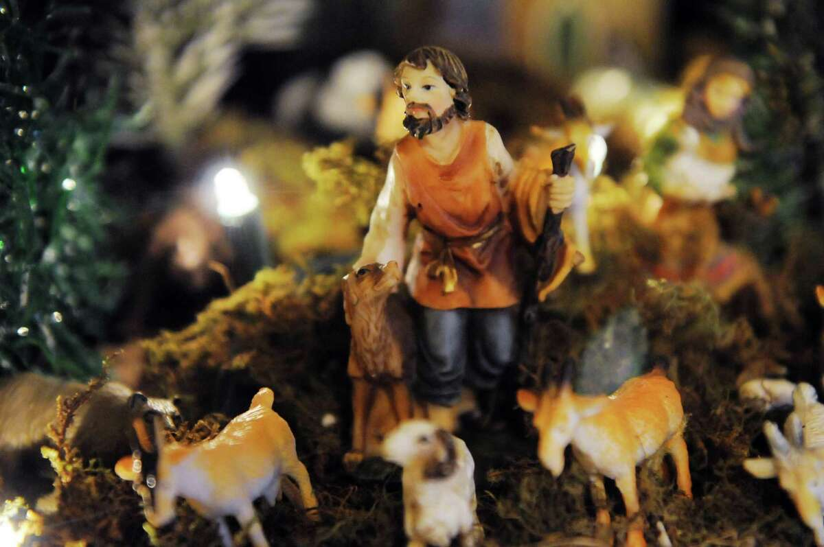 Figurines are displayed in Ralph Micale?s massive Nativity scene which he sets up each year in his Colonie, N.Y. Home, Monday Dec. 10, 2012. (Will Waldron / Times Union)