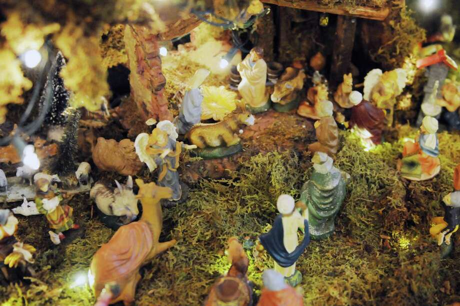 The manger is depicted in Ralph Micale?s massive Nativity scene which he sets up each year in his Colonie, N.Y. Home, Monday Dec. 10, 2012. (Will Waldron / Times Union) Photo: Will Waldron