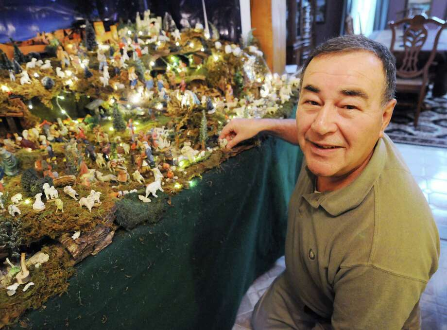 Ralph Micale in front of his massive Nativity scene, which he sets up each year in his Colonie, N.Y. Home, Monday Dec. 10, 2012. (Will Waldron / Times Union) Photo: Will Waldron