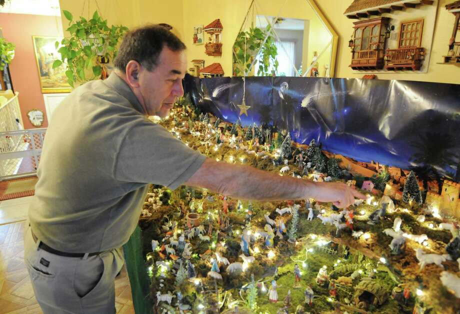 Ralph Micale points out of the highlight in his massive Nativity scene, which he sets up each year in his Colonie, N.Y. Home, Monday Dec. 10, 2012. (Will Waldron / Times Union) Photo: Will Waldron
