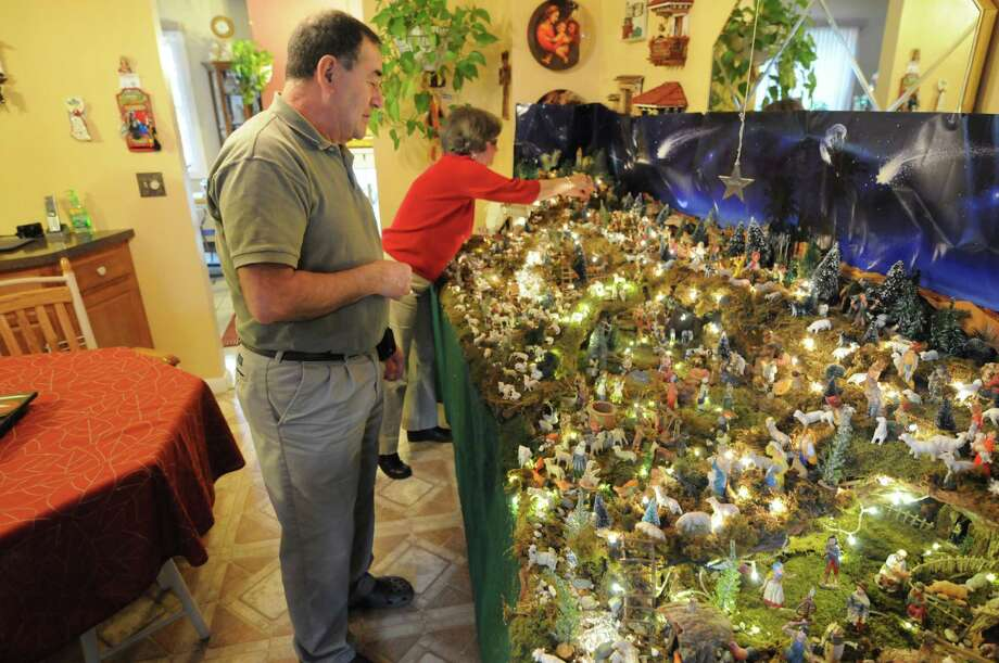 Ralph Micale, left, and his wife Alicia, center, look over Ralph's massive Nativity scene, which he sets up each year in his Colonie, N.Y. Home, Monday Dec. 10, 2012. (Will Waldron / Times Union) Photo: Will Waldron