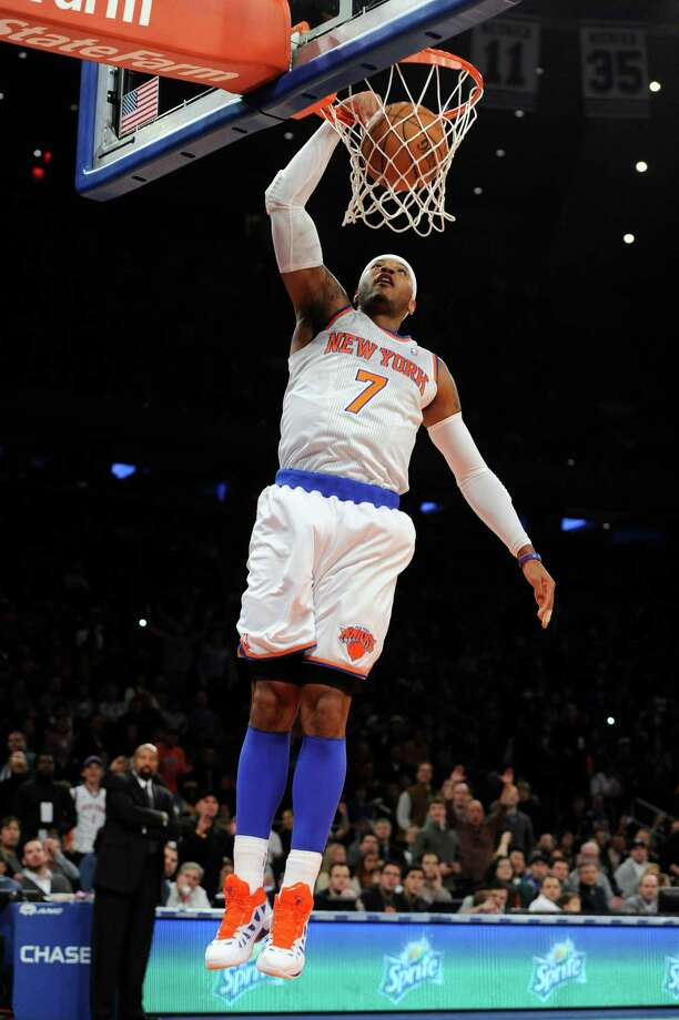 New York Knicks'  Carmelo Anthony (7) dunks a basket against the Minnesota Timberwolves in the first half of an NBA basketball game on Sunday, Dec., 23, 2012, at Madison Square Garden in New York. (AP Photo/Kathy Kmonicek) Photo: Kathy Kmonicek