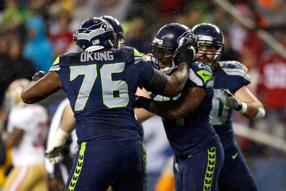 Russell Okung #76 and Marshawn Lynch #24 of the Seattle Seahawks celebrate after Lynch scored a 24-yard rushing touchdown in the first quarter against the San Francisco 49ers at Qwest Field on December 23, 2012 in Seattle, Washington.   (Otto Greule Jr / Getty Images)