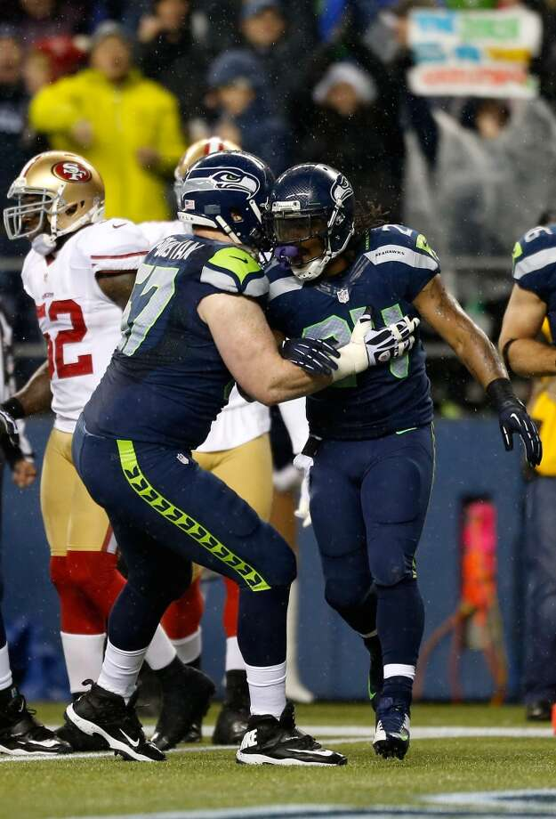 Paul McQuistan #67 and Marshawn Lynch #24 of the Seattle Seahawks celebrate after Lynch scored a 24-yard rushing touchdown in the first quarter against the San Francisco 49ers at Qwest Field on December 23, 2012 in Seattle, Washington.   (Otto Greule Jr / Getty Images)