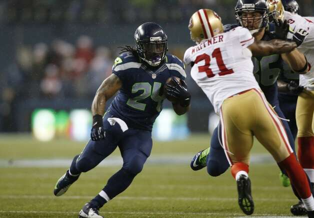 Seattle Seahawks' Marshawn Lynch (24) runs for a touchdown against the San Francisco 49ers in the first half of an NFL football game, Sunday, Dec. 23, 2012, in Seattle. (John Froschauer / Associated Press)