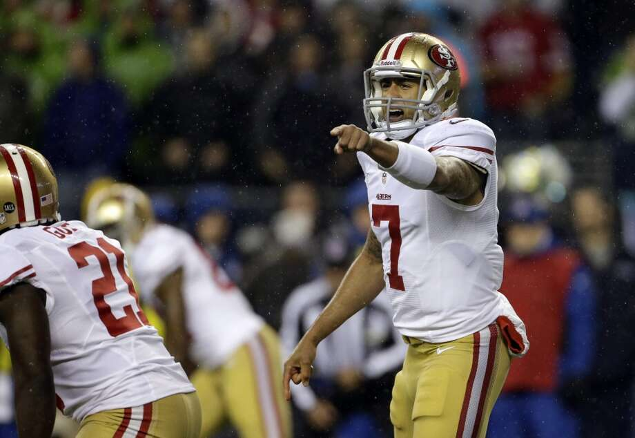 San Francisco 49ers quarterback Colin Kaepernick calls to his team in the first half of an NFL football game against the Seattle Seahawks, Sunday, Dec. 23, 2012, in Seattle.  (Elaine Thompson / Associated Press)