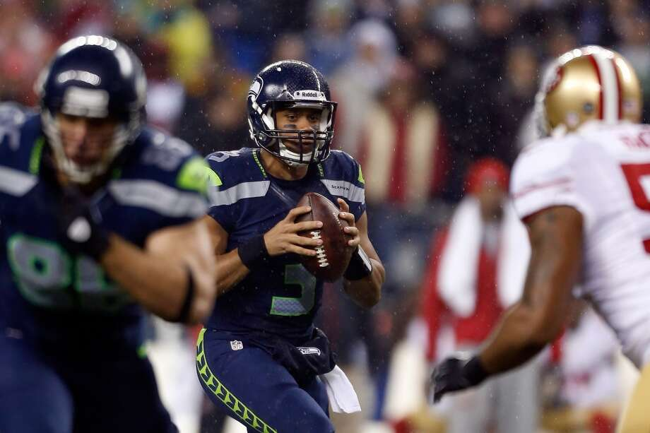 Russell Wilson #3 of the Seattle Seahawks looks to pass in the first half against the San Francisco 49ers at Qwest Field on December 23, 2012 in Seattle, Washington.  (Otto Greule Jr / Getty Images)