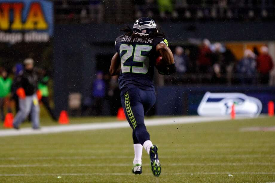 Richard Sherman #25 of the Seattle Seahawks returns a blocked field goal attempt 90 yards for a touchdown in the second quarter against the San Francisco 49ers at Qwest Field on December 23, 2012 in Seattle, Washington.  (Otto Greule Jr / Getty Images)