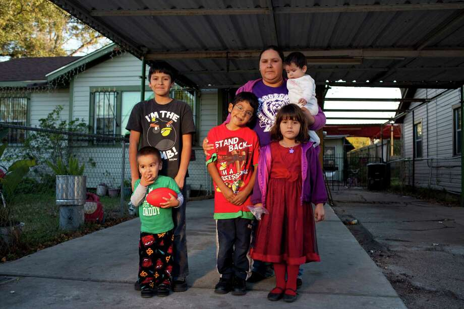 Aidee Alva and, from left, Yahir Eguia, 2, Gustavo Alva, 9, Jesus Alva, 6, Aidee, Emily Eguia, 5, and Brianna Marroqua, 8 months. Andres is not pictured. Photo: Eric Kayne / © 2012 Eric Kayne