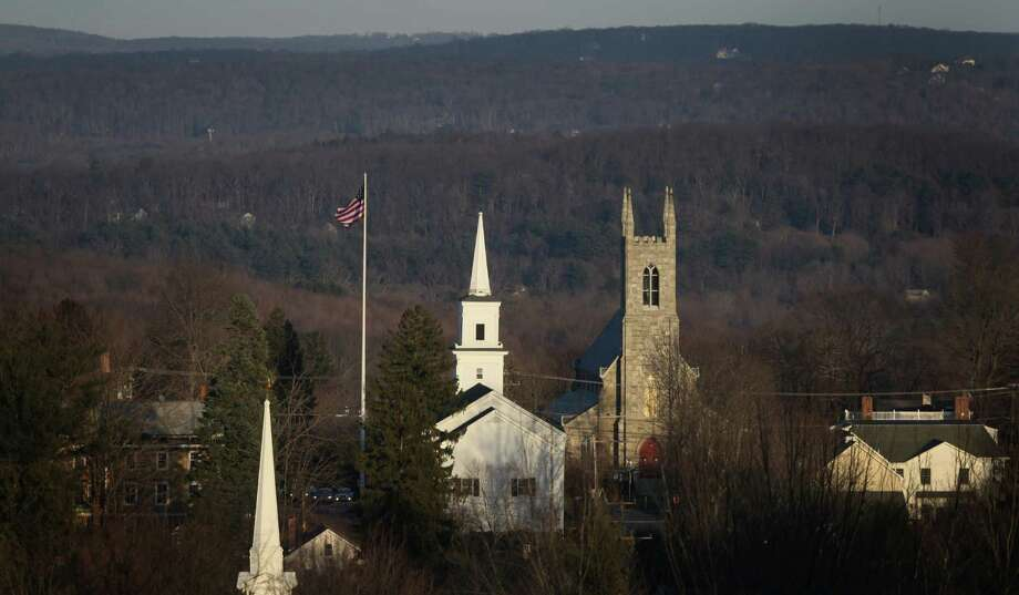 The flag in the center of Newtown flies at full mast as seen from Old Castle Drive on Sunday, December 23, 2012, nine days after 28 people were killed during a day of violence in Newtown. Photo: Joshua Trujillo, Joshua Trujillo/Hearst Newspaper / News-Times