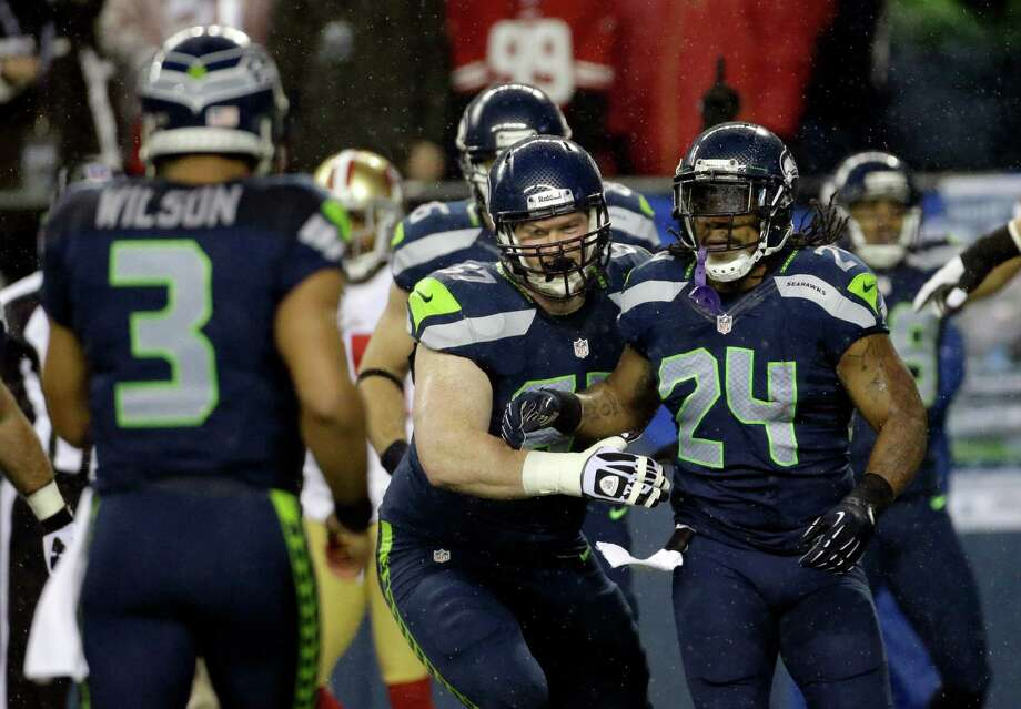 Seattle Seahawks' Marshawn Lynch (24) celebrates his touchdown against the San Francisco 49ers with Paul McQuistan, center, and quarterback Russell Wilson (3) in the first half of an NFL football game, Sunday, Dec. 23, 2012, in Seattle. Photo: AP