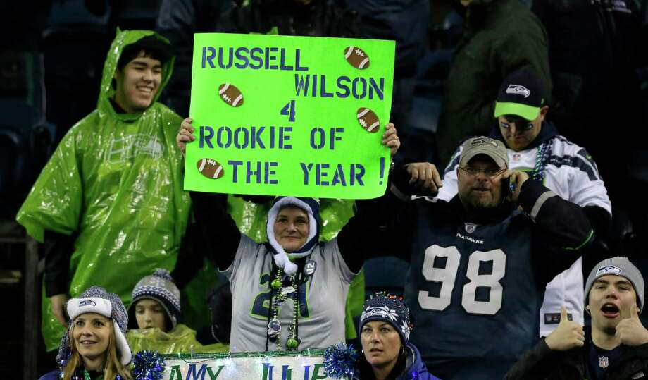 Seattle Seahawks fans cheer Seahawks' quarterback Russell Wilson in the first half of an NFL football game against the San Francisco 49ers, Sunday, Dec. 23, 2012, in Seattle. Photo: AP