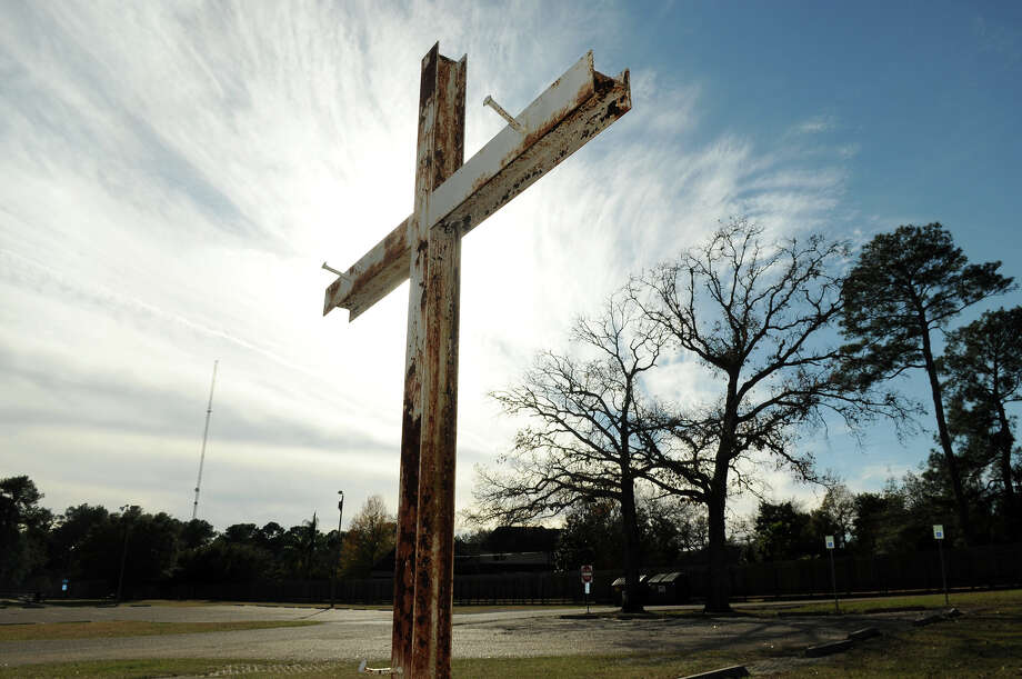 The 12-foot cross erected in Spring Creek Park in Tomball has sparked debate Photo: Jerry Baker, Freelance
