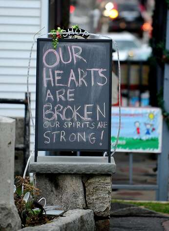 A sign in the Sandy Hook neighborhood of Newtown, Conn. Friday, Dec. 21, 2012 near a memorial for the victims of the Sandy Hook Elementary School shooting. Photo: Autumn Driscoll, Connecticut Post
