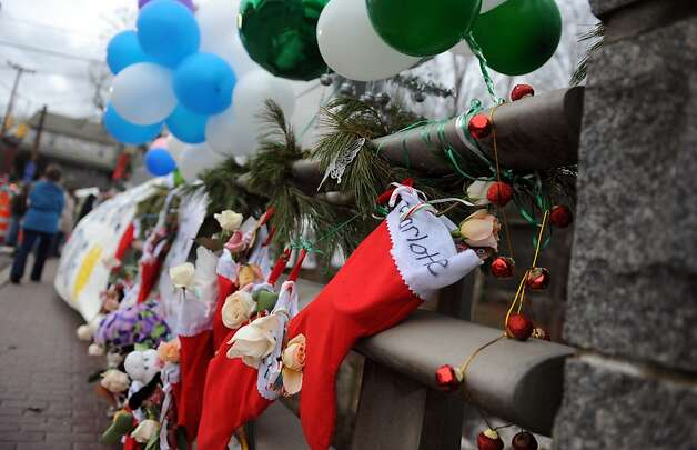 Stockings for victims of the Sandy Hook Elementary School shooting hang along a bridge near a memorial in Newtown, Conn. Friday, Dec. 21, 2012 Photo: Autumn Driscoll, Connecticut Post