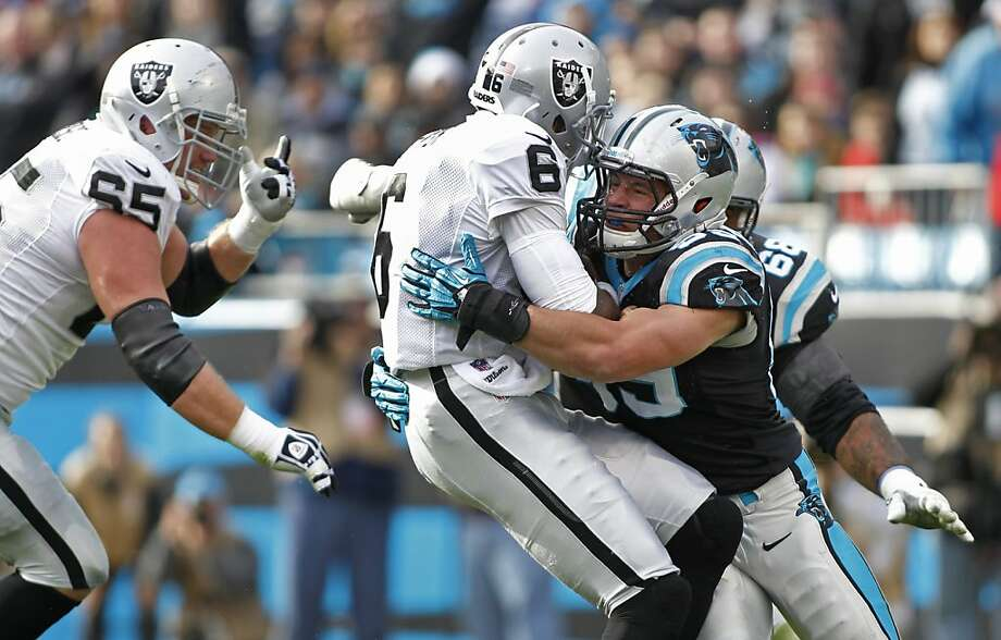 Panthers rookie Luke Kuechly (right) takes down the Raiders' Terrelle Pryor, one of the linebacker's nine unassisted tackles. Photo: Bob Leverone, Associated Press