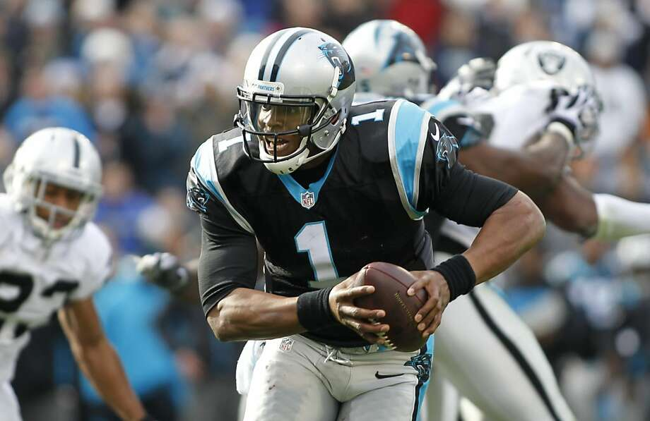Carolina Panthers' Cam Newton (1) scrambles against the Oakland Raiders during the first half of an NFL football game in Charlotte, N.C., Sunday, Dec. 23, 2012. (AP Photo/Bob Leverone) Photo: Bob Leverone, Associated Press
