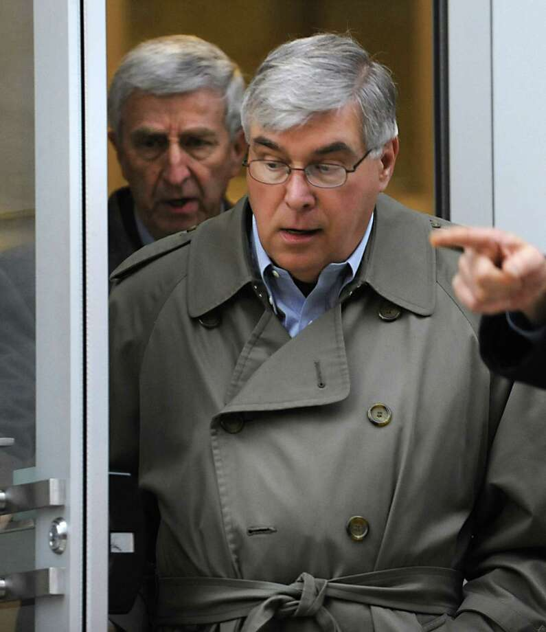 Timothy McGinn, right, and David Smith leave the U.S. District Courthouse after their arraignment for fraud Friday Jan. 27, 2012 in Albany, N.Y.  (Lori Van Buren / Times Union) Photo: Lori Van Buren / 00016245A