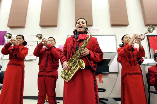 Brenda Garcia sings during a rehearsal early this month as students in the mariachi program at Irving Middle School prepare for a holiday show. Photo: Helen L. Montoya, San Antonio Express-News / ©SAN ANTONIO EXPRESS-NEWS