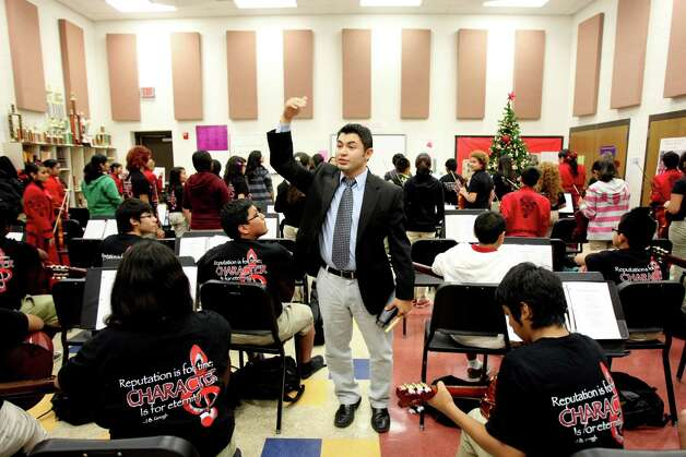 Cirilo Campos directs mariachi students at Irving, in the San Antonio ISD. His wife, Angela, leads the mariachi program at the North East ISD's Wood Middle School. Photo: Helen L. Montoya, San Antonio Express-News / ©SAN ANTONIO EXPRESS-NEWS