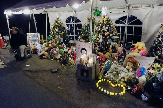 Christmas trees in memory of the victims of the Sandy Hook Elementary School massacre on Dickinson Drive in Newtown, Conn., Saturday night, Dec. 22, 2012. Photo: Bob Luckey
