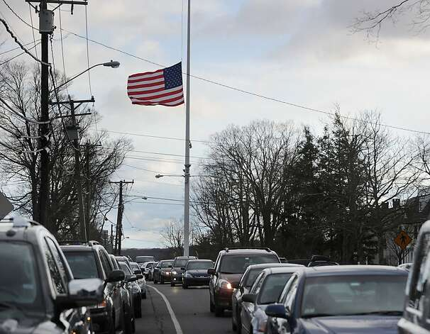 The American Flag in the center of Newtown, Conn., at half-staff in memory of the victims of the Sandy Hook Elementary School massacre, Saturday afternoon, Dec. 22, 2012. Photo: Bob Luckey