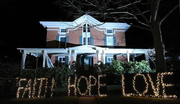 """Faith Hope Love"" reads the holiday lights on the front lawn of a house in downtown Sandy Hook which has turned into a shrine to the victims of the Sandy Hook Elementary School massacre, Newtown, Conn., Saturday, Dec. 22, 2012. Photo: Bob Luckey"