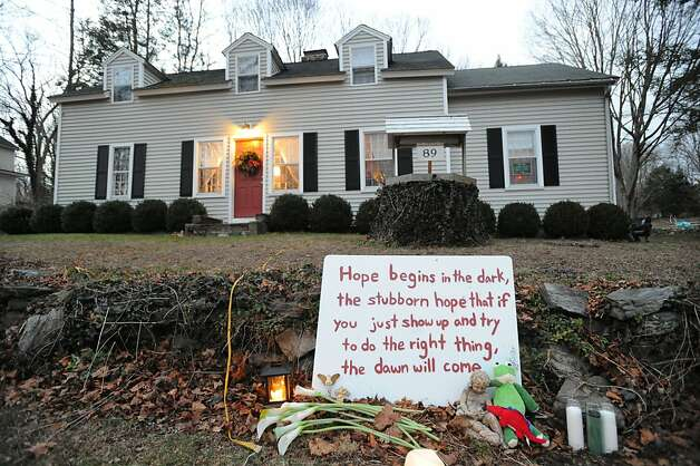 A sign about hope on the front lawn of a Church Hill Road home leading into downtown Sandy Hook, Conn., Saturday, Dec. 22, 2012. It has been more than a week since Adam Lanza slaughtered 26 people at Sandy Hook Elementary School with an automatic weapon. Photo: Bob Luckey