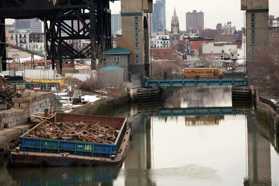 FILE - This file photo of March 2, 2010 shows the Gowanus Canal, which was added to the Superfund National Priorities List in 2010 for being heavily contaminated with PCBs, heavy metals, volatile organics and coal tar wastes. New York, New Jersey and EPA officials say toxic sites are OK after Superstorm Sandy, but The Associated Press has found that few actual tests have been done. (AP Photo/Mark Lennihan, File) Photo: Mark Lennihan