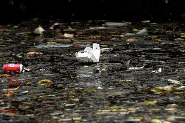 This Oct. 24, 2012 photo shows garbage floating on the surface of Dutch Kills, a navigable tributary of Newtown Creek in New York. Newtown Creek was added to the Superfund National Priorities List in 2010 for pesticides, metals, PCBs and volatile organic compounds. New York, New Jersey and EPA officials say toxic sites are OK after Superstorm Sandy, but The Associated Press has found that few actual tests have been done. (AP Photo/Mary Altaffer) Photo: Mary Altaffer