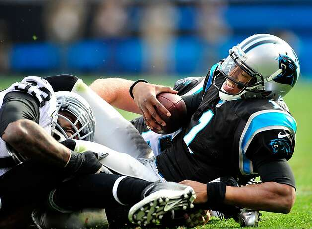 CHARLOTTE, NC - DECEMBER 23: Cam Newton #1 of the Carolina Panthers is sacked by Tommy Kelly #93 of the Oakland Raiders during play at Bank of America Stadium on December 23, 2012 in Charlotte, North Carolina. (Photo by Grant Halverson/Getty Images) Photo: Grant Halverson, Getty Images