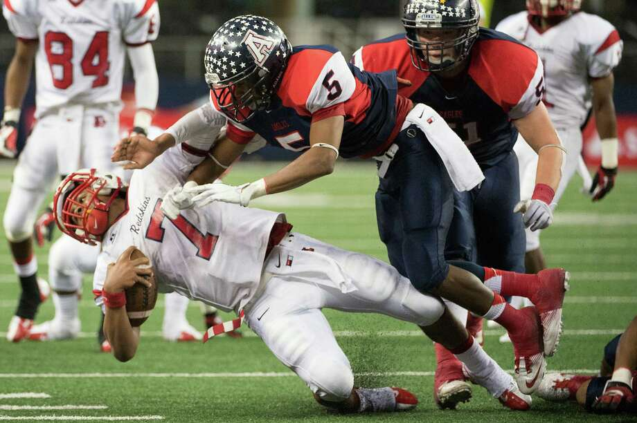 Lamar quarterback Darrell Colbert (7) is knocked off his feet by Allen defensive back Chad Adams (5) during the second half. Photo: Smiley N. Pool, Houston Chronicle / © 2012  Houston Chronicle