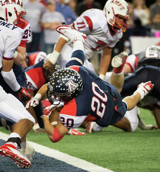 Allen running back Marcus Ward (20) dives into the end zone for a touchdown to break open a 21-21 ti