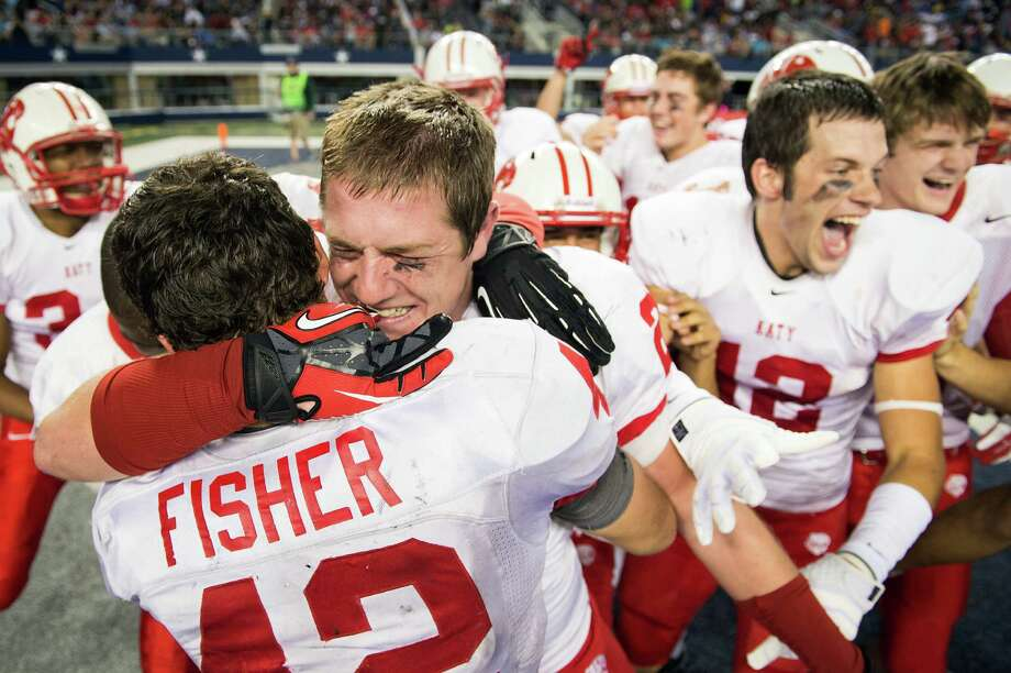 Katy defensive back Quinn Atwood, facing, celebrates with running back Alex Fisher (42) after the win. Photo: Smiley N. Pool, Houston Chronicle / © 2012  Houston Chronicle