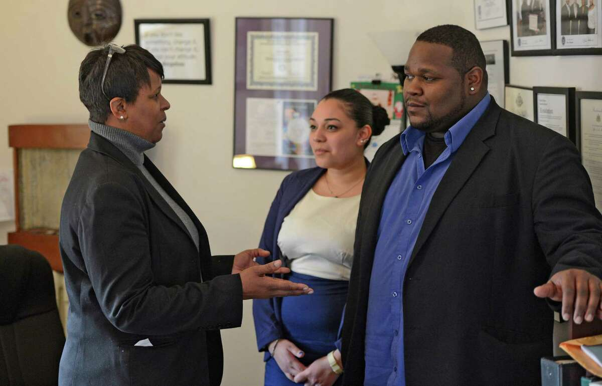 Meeting in the In Our Own Voices offices are (from left to right), Tandra LaGrone, Executive Director; Katherine Romero. LGBT Crime Victim Assistance Coordinator and Phillip Burse, Director of the Victim Services in Albany, N.Y. Dec 14, 2012. (Skip Dickstein/Times Union)