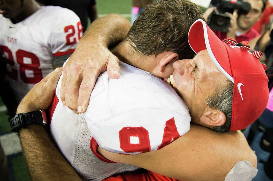 Katy head coach Gary Joseph  hugs defensive end Matt Dimon after the victory. Photo: Smiley N. Pool, Houston Chronicle / © 2012  Houston Chronicle